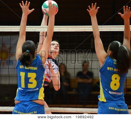 KAPOSVAR, HUNGARY - DECEMBER 12: Gabriella Kondor (13) blocks the ball at the Hungarian NB I. League woman volleyball game Kaposvar vs Eger on December 12, 2010 in Kaposvar, Hungary.