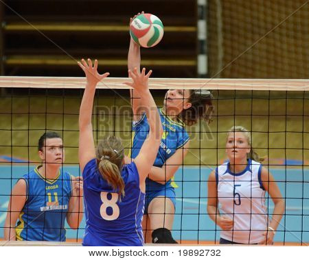 KAPOSVAR, HUNGARY - DECEMBER 19: Barbara Balajcza (2nd from R) in action at the Hungarian NB I. League woman volleyball game Kaposvar vs Palota Bollhoff on December 19, 2010 in Kaposvar, Hungary.