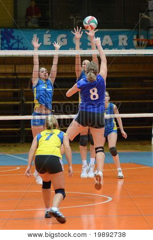 KAPOSVAR, HUNGARY - DECEMBER 19: Unidentifiedd players in action at the Hungarian NB I. League woman volleyball game Kaposvar vs Palota Bollhoff on December 19, 2010 in Kaposvar, Hungary.