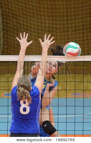 KAPOSVAR, HUNGARY - DECEMBER 19: Barbara Balajcza (R) in action at the Hungarian NB I. League woman volleyball game Kaposvar vs Palota Bollhoff on December 19, 2010 in Kaposvar, Hungary.