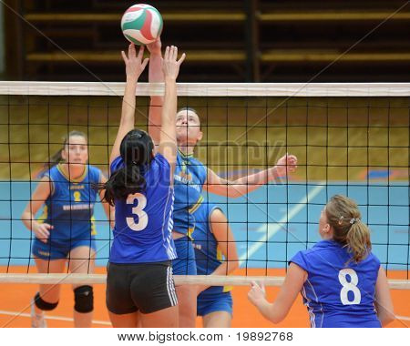 KAPOSVAR, HUNGARY - DECEMBER 19: Marianna Palfy (3rd from L) in action at the Hungarian NB I. League woman volleyball game Kaposvar vs Palota Bollhoff on December 19, 2010 in Kaposvar, Hungary.