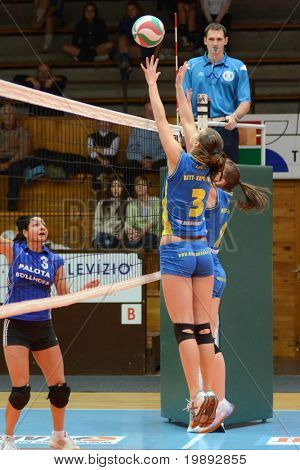 KAPOSVAR, HUNGARY - DECEMBER 19: Zsofia Harmath (3) blocks the ball at the Hungarian NB I. League woman volleyball game Kaposvar vs Palota Bollhoff on December 19, 2010 in Kaposvar, Hungary.