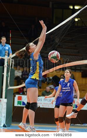 KAPOSVAR, HUNGARY - DECEMBER 19: Kamilla Gyorbiro (L) blocks the ball at the Hungarian NB I. League woman volleyball game Kaposvar vs Palota Bollhoff on December 19, 2010 in Kaposvar, Hungary.
