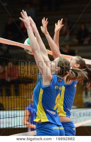 KAPOSVAR, HUNGARY - DECEMBER 19: Rebeka Rak (L) blocks the ball at the Hungarian NB I. League woman volleyball game Kaposvar vs Palota Bollhoff on December 19, 2010 in Kaposvar, Hungary.