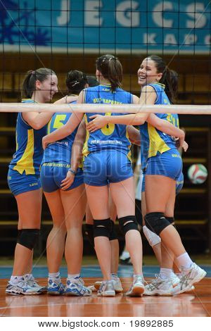 KAPOSVAR, HUNGARY - DECEMBER 19: Kaposvar players celebrate at the Hungarian NB I. League woman volleyball game Kaposvar vs Palota Bollhoff on December 19, 2010 in Kaposvar, Hungary.