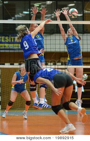 KAPOSVAR, HUNGARY - DECEMBER 19: Alexandra Csaszar (15) blocks the ball at the Hungarian NB I. League woman volleyball game Kaposvar vs Palota Bollhoff on December 19, 2010 in Kaposvar, Hungary.