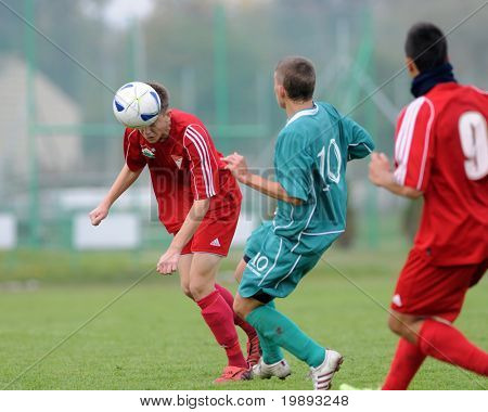 KAPOSVAR, HUNGARY - OCTOBER 16: Krisztian Garai (C) in action at the Hungarian National Championship under 19 game between Kaposvar and Debrecen October 16, 2010 in Kaposvar, Hungary.