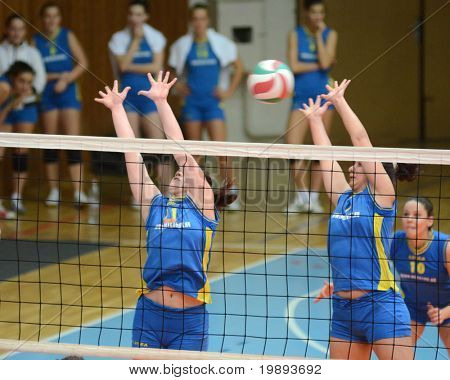 KAPOSVAR, HUNGARY - JANUARY 14: Marianna Palfy (L) blocks the ball at the Hungarian NB I. League woman volleyball game Kaposvar vs Ujbuda, January 14, 2011 in Kaposvar, Hungary.