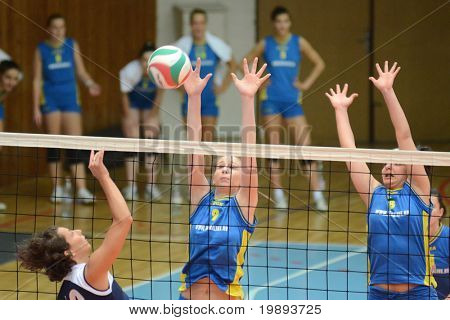KAPOSVAR, HUNGARY - JANUARY 14: Rebeka Rak (C) blocks the ball at the Hungarian NB I. League woman volleyball game Kaposvar vs Ujbuda, January 14, 2011 in Kaposvar, Hungary.