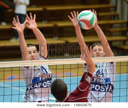KAPOSVAR, HUNGARY - JANUARY 17: Krisztian Csoma (R) blocks the ball at a Hungarian volleyball National Championship game (Kaposvar vs Dunaferr), on January 17, 2011 in Kaposvar, Hungary.