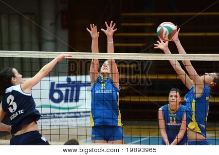 KAPOSVAR, HUNGARY - JANUARY 14: Zsanett Pinter (2) blocks the ball at the Hungarian NB I. League woman volleyball game Kaposvar vs Ujbuda, January 14, 2011 in Kaposvar, Hungary.