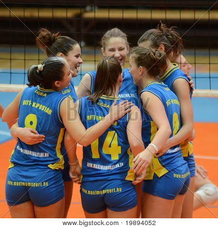 KAPOSVAR, HUNGARY - JANUARY 14: Kaposvar players celebrate at the Hungarian NB I. League woman volleyball game Kaposvar vs Ujbuda, January 14, 2011 in Kaposvar, Hungary.