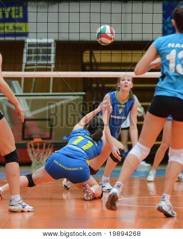 KAPOSVAR, HUNGARY - JANUARY 23: Marianna Palfy (11) receives the ball at the Hungarian NB I. League woman volleyball game Kaposvar vs Miskolc, January 23, 2011 in Kaposvar, Hungary.