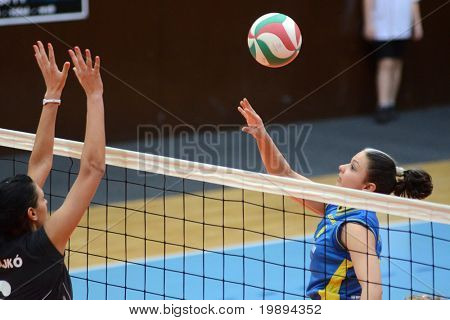 KAPOSVAR, HUNGARY - JANUARY 23: Barbara Balajcza (R) in action at the Hungarian NB I. League woman volleyball game Kaposvar vs Miskolc, January 23, 2011 in Kaposvar, Hungary.