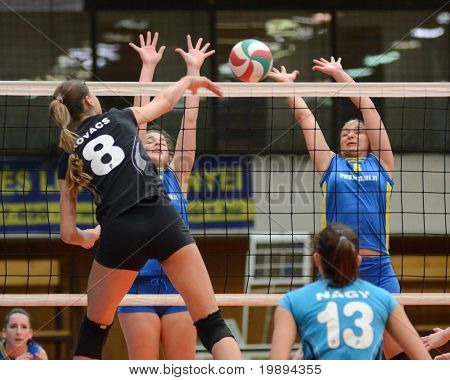 KAPOSVAR, HUNGARY - JANUARY 23: Barbara Balajcza (R) blocks the ball at the Hungarian NB I. League woman volleyball game Kaposvar vs Miskolc, January 23, 2011 in Kaposvar, Hungary.