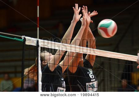 KAPOSVAR, HUNGARY - JANUARY 23: Unidentified players block the ball at the Hungarian NB I. League woman volleyball game Kaposvar vs Miskolc, January 23, 2011 in Kaposvar, Hungary.