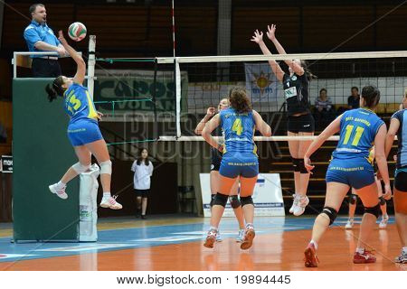 KAPOSVAR, HUNGARY - JANUARY 23: Gabriella Kondor (13) strikes the ball at the Hungarian NB I. League woman volleyball game Kaposvar vs Miskolc, January 23, 2011 in Kaposvar, Hungary.