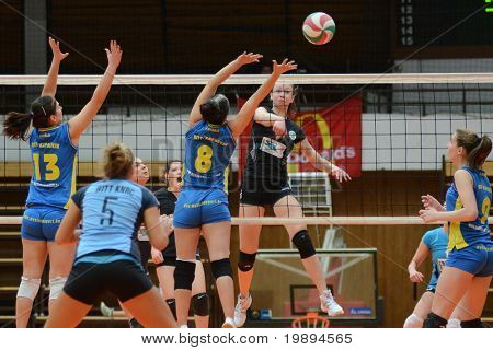 KAPOSVAR, HUNGARY - JANUARY 23: Barbara Balajcza (8) blocks the ball at the Hungarian NB I. League woman volleyball game Kaposvar vs Miskolc, January 23, 2011 in Kaposvar, Hungary.
