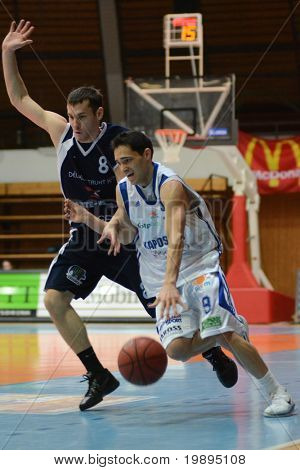 KAPOSVAR, HUNGARY - JANUARY 26: Tamas Markus (R) in action at a Hugarian Cup basketball game Kaposvar vs. Szeged January 26, 2011 in Kaposvar, Hungary.