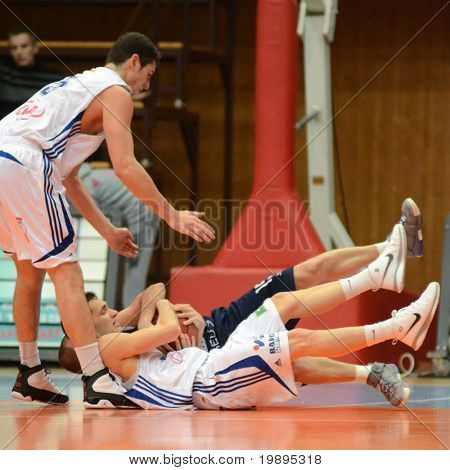KAPOSVAR, HUNGARY - JANUARY 26: Gabor Soos (L) in action at a Hugarian Cup basketball game Kaposvar vs. Szeged January 26, 2011 in Kaposvar, Hungary.