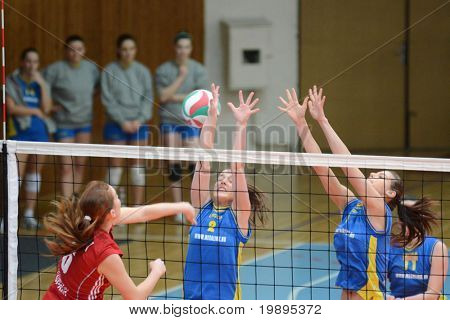KAPOSVAR, HUNGARY - FEBRUARY 4: Zsanett Pinter (2) strikes the ball at the Hungarian NB I. League woman volleyball game Kaposvar vs Szolnok, February 4, 2011 in Kaposvar, Hungary.