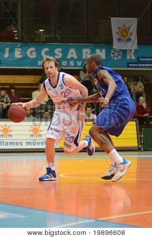 KAPOSVAR, HUNGARY - FEBRUARY 26: Joshua Wilson (L) in action at a Hungarian National Championship basketball game Kaposvar vs Albacomp on February 26, 2011 in Kaposvar, Hungary.