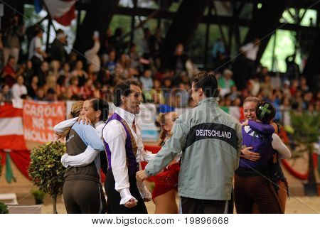 KAPOSVAR, HUNGARY - AUGUST 12: German competitors celebrate at the Vaulting World Championship Final on August 12, 2007 in Kaposvar, Hungary.
