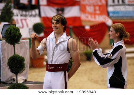 KAPOSVAR, HUNGARY - AUGUST 12: Dennis Peiler (L) (GER) in action at the Vaulting World Championship Final on August 12, 2007 in Kaposvar, Hungary.