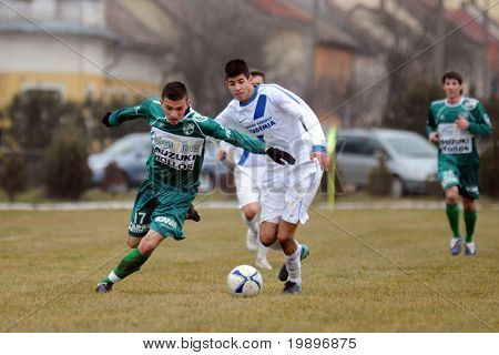 KAPOSVAR, HUNGARY - MARCH 5: Patrik Bojte (L) in action at the Hungarian National Championship under 19 game between Kaposvar and MTK on March 5, 2011 in Kaposvar, Hungary.
