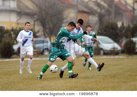 KAPOSVAR, HUNGARY - MARCH 5: Patrik Bojte (17) in action at the Hungarian National Championship under 19 game between Kaposvar and MTK on March 5, 2011 in Kaposvar, Hungary.
