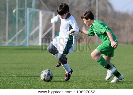 KAPOSVAR, HUNGARY - MARCH 9: Mark Krall (R) and Soma Ozorai (L) in action at the Hungarian National Championship under 13 game between Kaposvar and Airnergy FC on March 9, 2011 in Kaposvar, Hungary.
