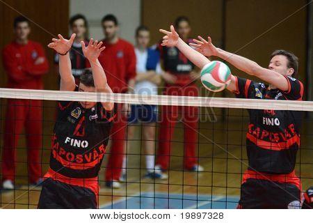 KAPOSVAR, HUNGARY - MARCH 6: Krisztian Csoma (R) blocks the ball at a Hungarian National Championship volleyball game Kaposvar vs. Kazincbarcika, March 6, 2011 in Kaposvar, Hungary.