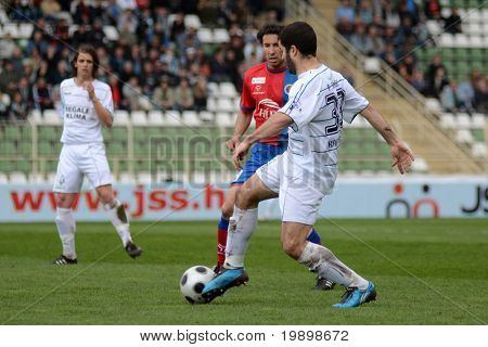 KAPOSVAR, HUNGARY - APRIL 1: Pedro Sass (R) in action at a Hungarian National Championship soccer game - Kaposvar vs Vasas on April 1, 2011 in Kaposvar, Hungary.