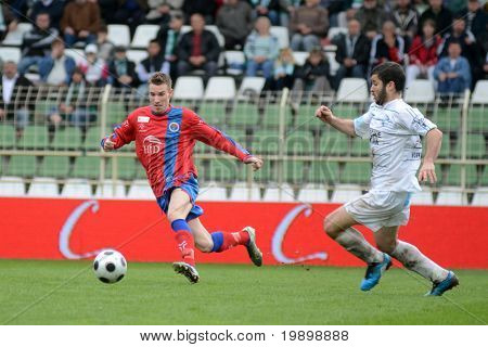 KAPOSVAR, HUNGARY - APRIL 1: Pedro Sass (in white) in action at a Hungarian National Championship soccer game - Kaposvar vs Vasas on April 1, 2011 in Kaposvar, Hungary.