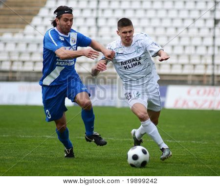 KAPOSVAR, HUNGARY - APRIL 16: Benjamin Balazs (R) in action at a Hungarian National Championship soccer game - Kaposvar vs MTK Budapest on April 16, 2011 in Kaposvar, Hungary.