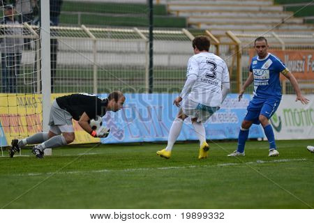 KAPOSVAR, HUNGARY - APRIL 16: Milan Peric (C) in action at a Hungarian National Championship soccer game - Kaposvar vs MTK Budapest on April 16, 2011 in Kaposvar, Hungary.