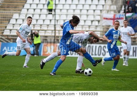 KAPOSVAR, HUNGARY - APRIL 16: Sandor Hajdu (3) in action at a Hungarian National Championship soccer game - Kaposvar vs MTK Budapest on April 16, 2011 in Kaposvar, Hungary.