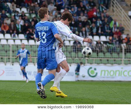 KAPOSVAR, HUNGARY - APRIL 16: Milan Peric (R) in action at a Hungarian National Championship soccer game - Kaposvar vs MTK Budapest on April 16, 2011 in Kaposvar, Hungary.
