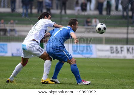 KAPOSVAR, HUNGARY - APRIL 16: Daniane Jawad (in white) in action at a Hungarian National Championship soccer game - Kaposvar vs MTK Budapest on April 16, 2011 in Kaposvar, Hungary.