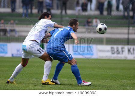 KAPOSVAR, HUNGARY - APRIL 16: Daniane Jawad (in white) in action at a Hungarian National Championship soccer game - Kaposvar vs MTK Budapest on April 16, 2011 in Kaposvar, Hungary.