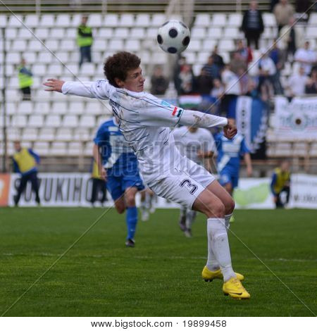 KAPOSVAR, HUNGARY - APRIL 16: Milan Peric (3) in action at a Hungarian National Championship soccer game - Kaposvar vs MTK Budapest on April 16, 2011 in Kaposvar, Hungary.