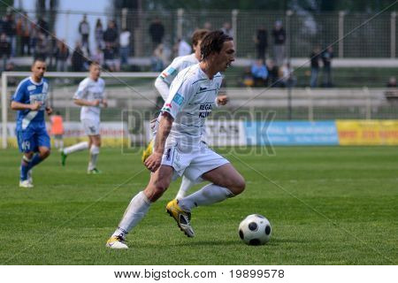 KAPOSVAR, HUNGARY - APRIL 16: Lorant Olah (R) in action at a Hungarian National Championship soccer game - Kaposvar vs MTK Budapest on April 16, 2011 in Kaposvar, Hungary.