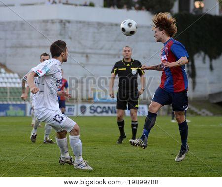KAPOSVAR, HUNGARY - APRIL 27: Attila Polonkai (R) in action at aHungarian National Cup soccer game Kaposvar vs Videoton April 27, 2011 in Kaposvar, Hungary.