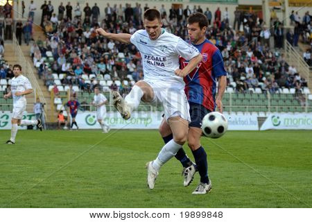 KAPOSVAR, HUNGARY - APRIL 20: Nikolic Nemanja (R) in action at a Hungarian National Cup soccer game Kaposvar vs Videoton April 20, 2011 in Kaposvar, Hungary.