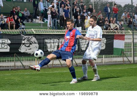 KAPOSVAR, HUNGARY - APRIL 20: Andre Alves (in blue) in action at a Hungarian National Cup soccer game Kaposvar vs Videoton April 20, 2011 in Kaposvar, Hungary.
