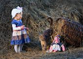 stock photo of tilde  - little girl and cat in the hayloft - JPG
