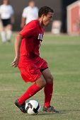 NORTHRIDGE, CA. - AUGUST 28: Nicholas DeLeon dribbling up field during the UNLV vs. CSUN pre-season