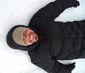 foto of ruddy-faced  - happy man on the snow - JPG