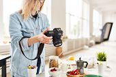 Professional food photographer shooting healthy food for stocks poster