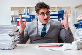 Businessman busy with much paperwork poster